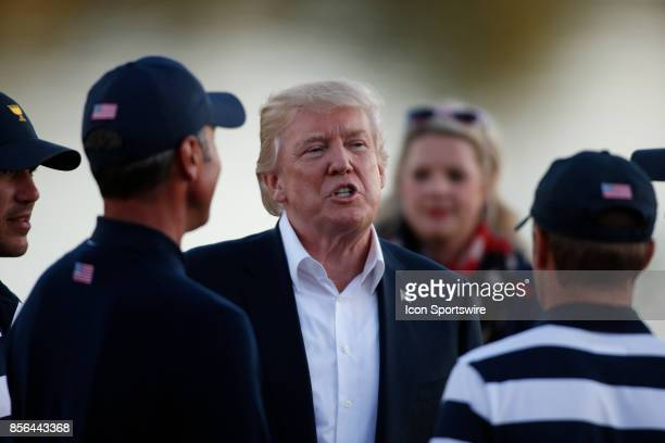 Donald Trump the 45th president of the United States talks to USA golfers Matt Kuchar and Jordan Spieth after the final round of the Presidents Cup...