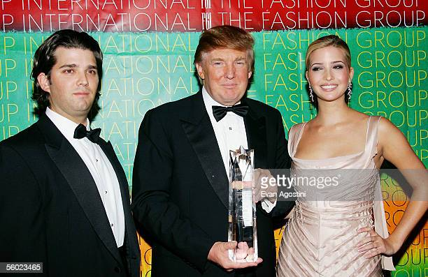 Donald Trump Visionary Business Leader award honoree poses with his children Donald Trump Jr and Ivanka at Fashion Group International's 22nd Annual...