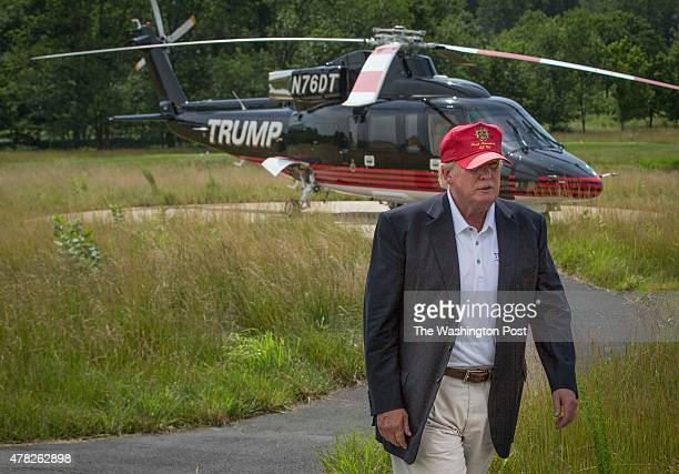 Donald Trump walks past his helicopter at the opening of his championship golf course in Sterling VA June 23