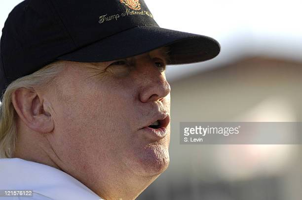 Donald Trump watches the action during the third round of the ADT Championship at the Trump International Golf Club in West Palm Beach Florida on...