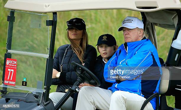 Donald Trump watches the action with wife Melania and son Barron during the Third Round of the Ricoh Women's British Open at Turnberry Golf Club on...