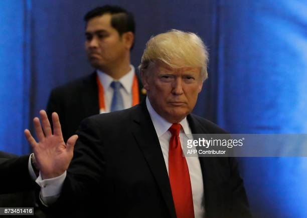 US Donald Trump waves as he arrives during the ASEANUS 40th Anniversary Commemorative Summit on the sideline of the 31st Association of Southeast...