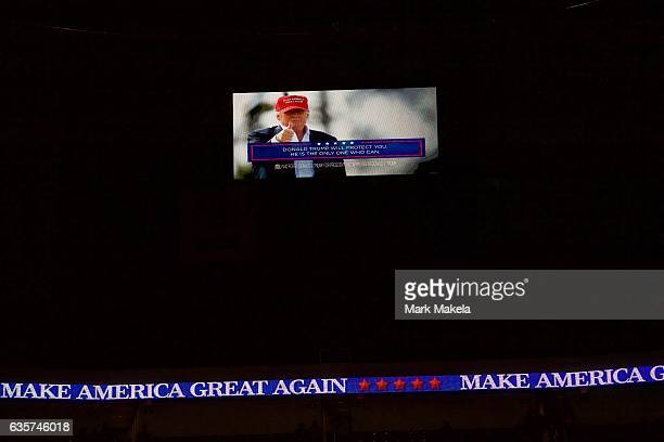 Donald Trump's slogan 'Make America Great Again' scrolls around the arena during a rally for Republican Presidential nominee Donald J Trump November...