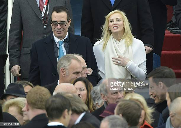Donald Trump's Treasury nominee Steven Mnuchin and his wife Louise Linton are greeted upon arrival on the platform of the US Capitol in Washington DC...