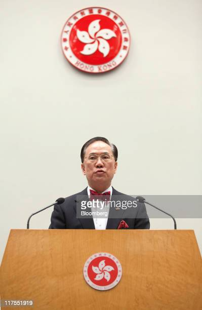 Donald Tsang chief executive of Hong Kong right speaks after appointing Gregory So unseen to the position of secretary for commerce and economic...