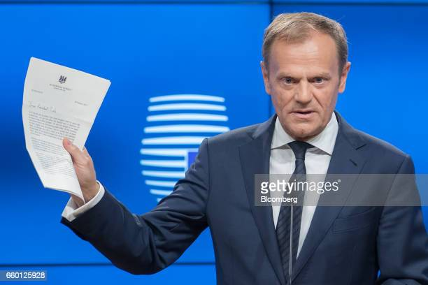 Donald Tusk president of the European Union holds the letter invoking Article 50 of the Lisbon Treaty from the UK Prime Minister as he speaks during...