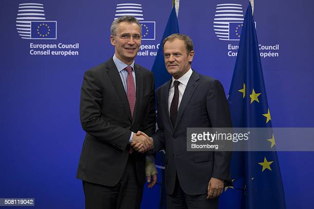 Donald Tusk president of the European Union right poses for a photograph with Jens Stoltenberg secretary general of the North Atlantic Treaty...