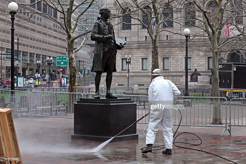Donald Ware, an employee of Boston Parks and Recreation, washes down the square around the statue of painter John Singleton Copley on April 23, 2013 in Boston, Massachusetts. The city conducted a final cleanup of Boylston Street and started opening the street to residents and business owners.