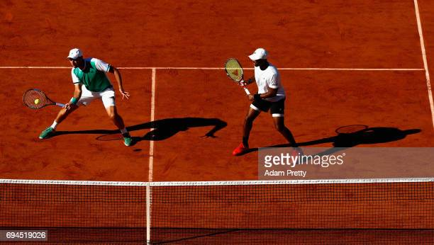 Donald Young of The United States and partner Santiago Gonzalez of Mexico return the ball during the mens doubles final match against Ryan Harrison...