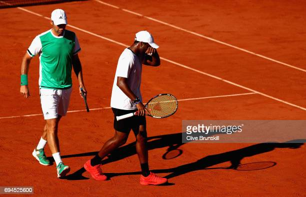 Donald Young of The United States and partner Santiago Gonzalez of Mexico speak during the mens doubles final match against Ryan Harrison of The...