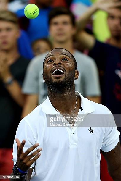 Donald Young of the United States celebrates after defeating Viktor Troicki of Serbia during their Men's Singles Third Round match on Day Six of the...