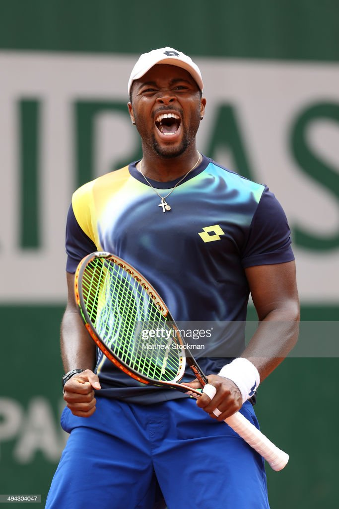 Donald Young of the United States celebrates victory in his men's singles match against Feliciano Lopez of Spain on day five of the French Open at Roland Garros on May 29, 2014 in Paris, France.