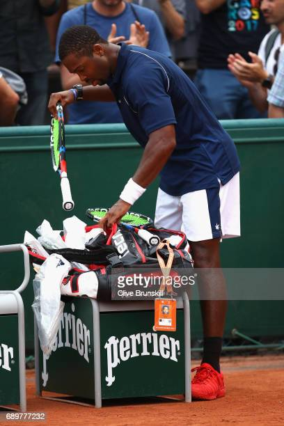 Donald Young of The United States leaves the court following defeat during the mens singles first round match against David Ferrer of Spain on day...