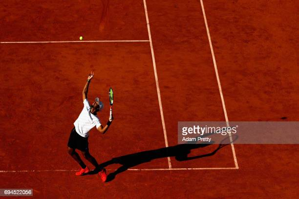 Donald Young of The United States partner of Santiago Gonzalez of Mexico serves during the mens doubles final match against Ryan Harrison of The...