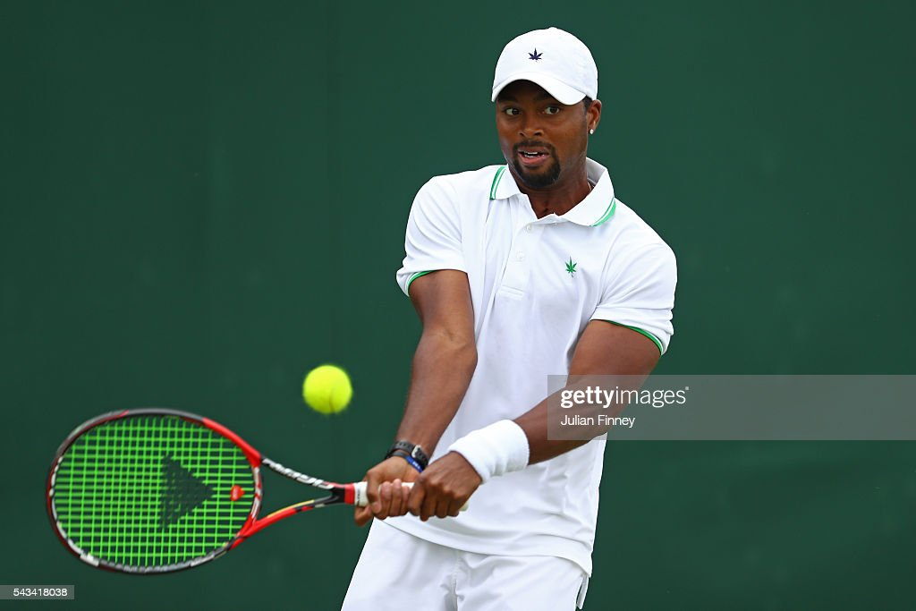 <a gi-track='captionPersonalityLinkClicked' href=/galleries/search?phrase=Donald+Young+-+Tennis+Player&family=editorial&specificpeople=194754 ng-click='$event.stopPropagation()'>Donald Young</a> of The United States plays a backhand during the Men's Singles first round match foreLeonardo Mayer of Argentina on day two of the Wimbledon Lawn Tennis Championships at the All England Lawn Tennis and Croquet Club on June 28, 2016 in London, England.