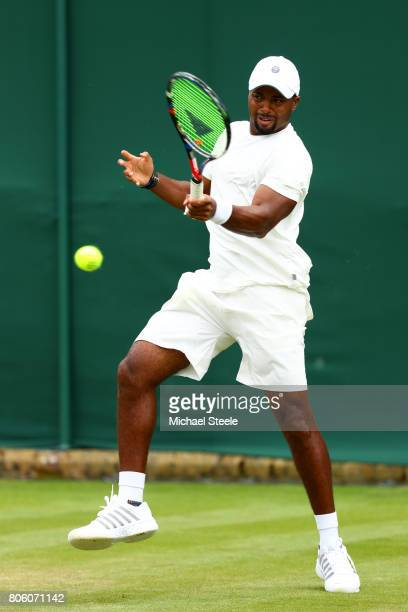 Donald Young of the United States plays a forehand during the Gentlemen's Singles first round match against Denis Istomin of Uzbekistan on day one of...