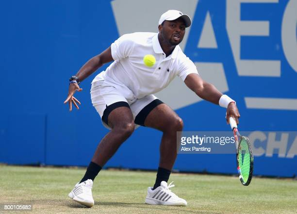 Donald Young of The United States plays a forehand during the mens singles quarter finals match against Marin Cilic of Croatia on day five of the...