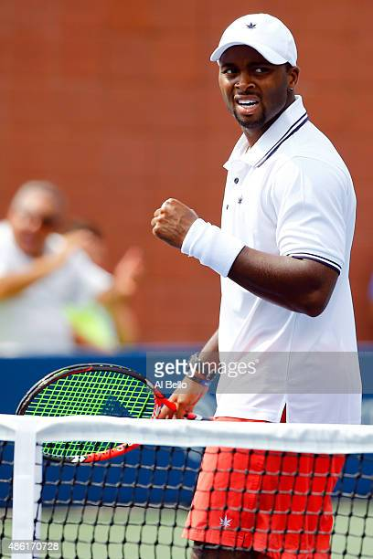 Donald Young of the United States reacts after defeating Gilles Simon of France during their Men's Singles First Round match on Day Two of the 2015...