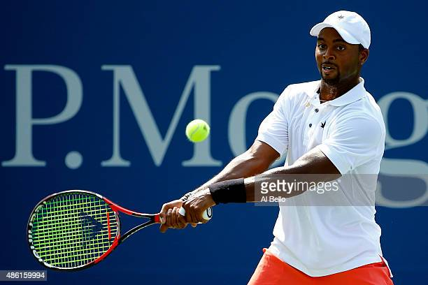 Donald Young of the United States returns a shot to Gilles Simon of France during their Men's Singles First Round match on Day Two of the 2015 US...
