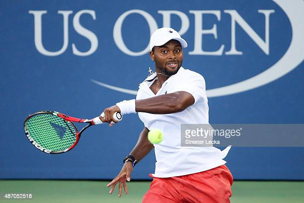 Donald Young of the United States returns a shot to Viktor Troicki of Serbia during their Men's Singles Third Round match on Day Six of the 2015 US...