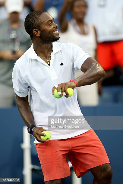 Donald Young of the United States throws balls out to the crowd after defeating Viktor Troicki of Serbia during their Men's Singles Third Round match...
