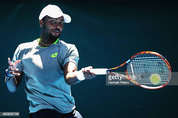 Donald Young of the USA plays a forehand during his qualifying match against Artem Sitak of New Zealand during day one of the Heineken Open at ASB...