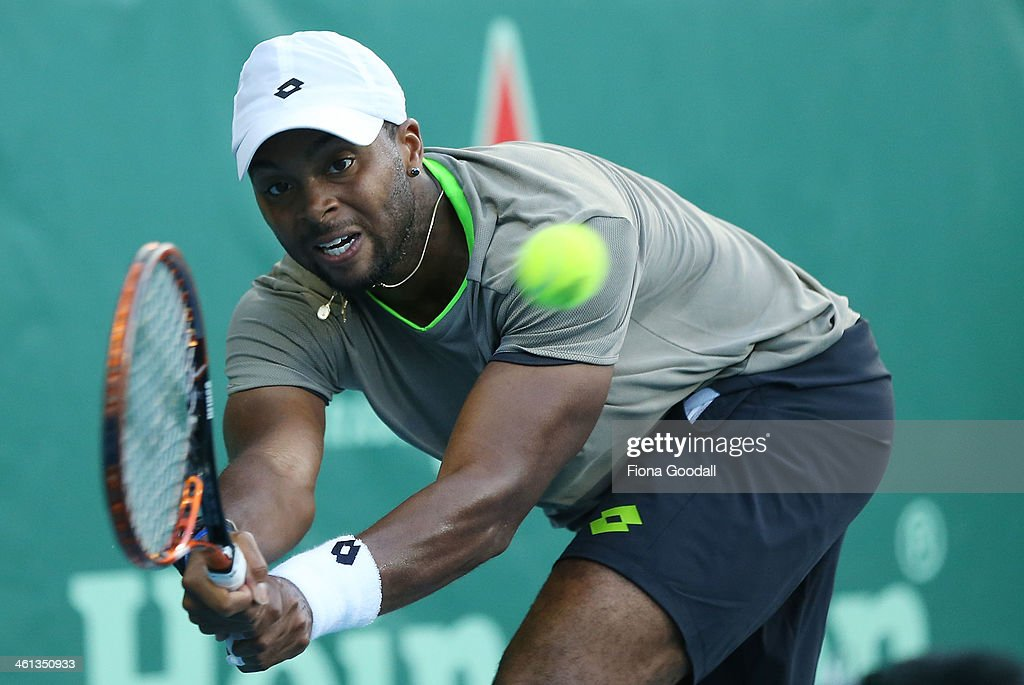 Donald Young of USA plays a shot against David Ferrer of Spain during day three of the Heineken Open at ASB Tennis Centre on January 8, 2014 in Auckland, New Zealand.