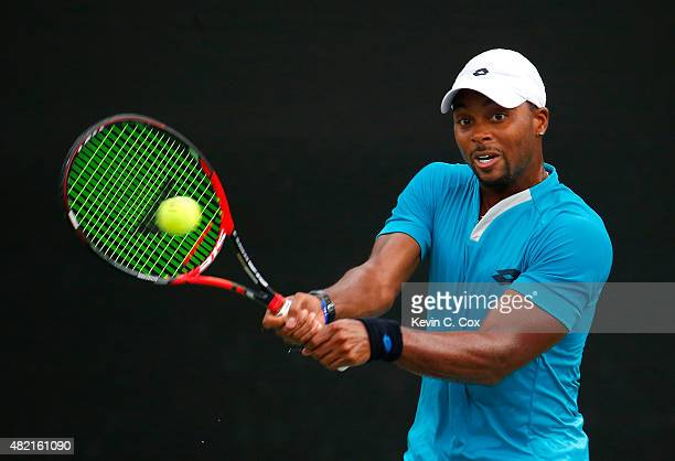 Donald Young returns a backhand to Gilles Muller of Luxembourg during the BBT Atlanta Open at Atlantic Station on July 27 2015 in Atlanta Georgia