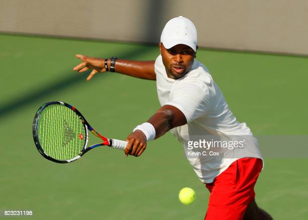 Donald Young returns a backhand to Lukas Lacko of Slovakia during the BBT Atlanta Open at Atlantic Station on July 26 2017 in Atlanta Georgia