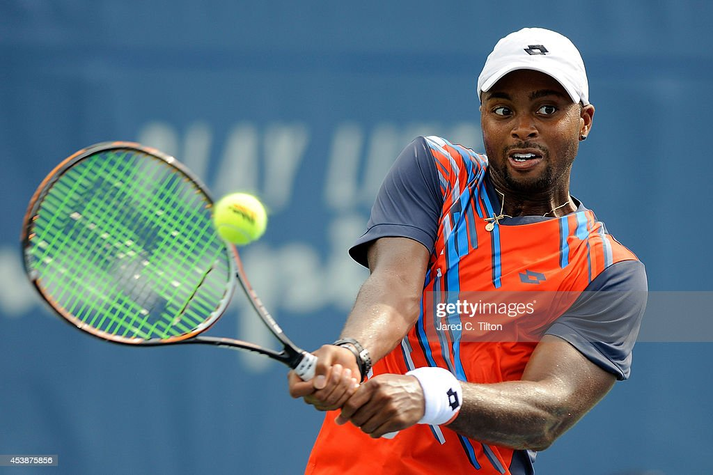 Donald Young returns a shot from Guillermo Garcia-Lopez of Spain during the Winston-Salem Open at Wake Forest University on August 20, 2014 in Winston Salem, North Carolina.