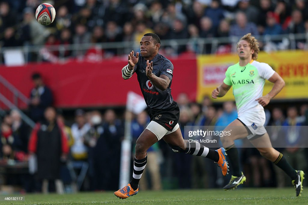 Donasio Ratubuli Naturaga #8 of Fiji gets ba pass away during the Tokyo Sevens, in the six round of the HSBC Sevens World Series at the Prince Chichibu Memorial Ground on March 23, 2014 in Tokyo, Japan.