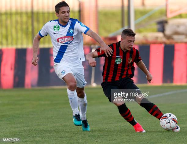 Donat Zsoter of Budapest Honved wins the ball from Drazen Okuka of MTK Budapest during the Hungarian OTP Bank Liga match between Budapest Honved and...
