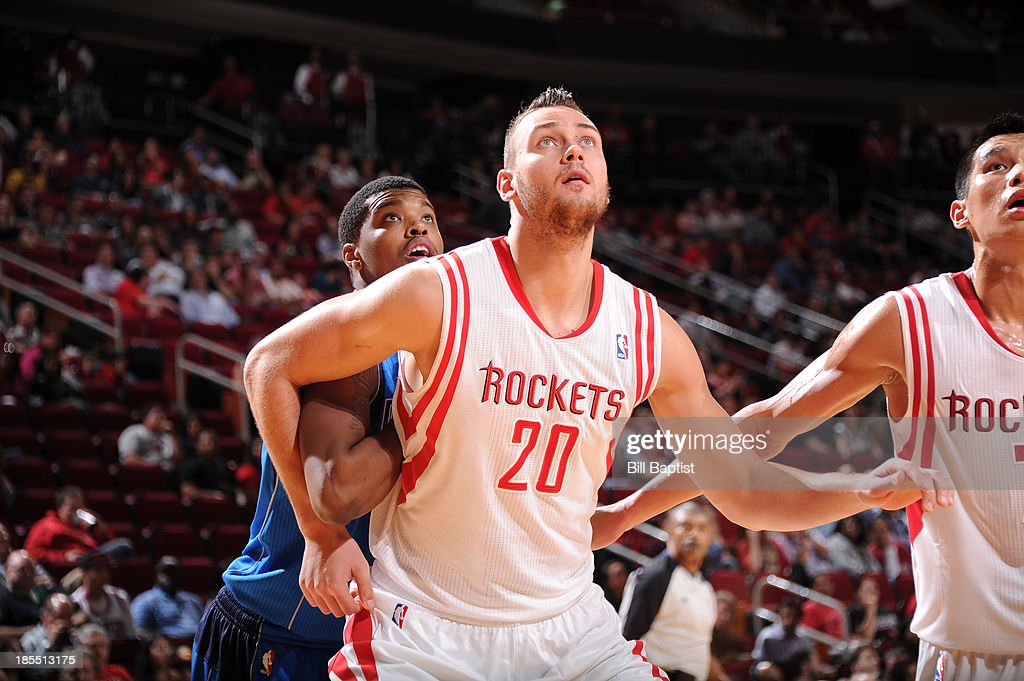 <a gi-track='captionPersonalityLinkClicked' href=/galleries/search?phrase=Donatas+Motiejunas&family=editorial&specificpeople=5561687 ng-click='$event.stopPropagation()'>Donatas Motiejunas</a> #20 of the Houston Rockets and <a gi-track='captionPersonalityLinkClicked' href=/galleries/search?phrase=Ricky+Ledo&family=editorial&specificpeople=10933759 ng-click='$event.stopPropagation()'>Ricky Ledo</a> #7 of the Dallas Mavericks battle for the rebound during a 2013 NBA pre-season game on October 21, 2013 at the Toyota Center in Houston, Texas.