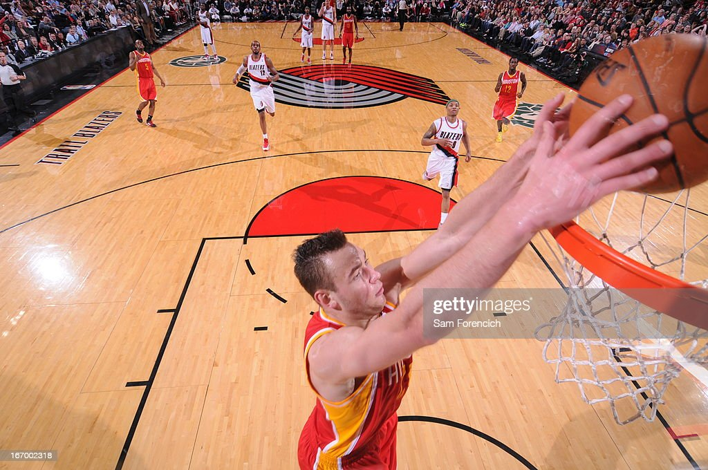 <a gi-track='captionPersonalityLinkClicked' href=/galleries/search?phrase=Donatas+Motiejunas&family=editorial&specificpeople=5561687 ng-click='$event.stopPropagation()'>Donatas Motiejunas</a> #20 of the Houston Rockets dunks the ball against the Portland Trail Blazers on April 5, 2013 at the Rose Garden Arena in Portland, Oregon.