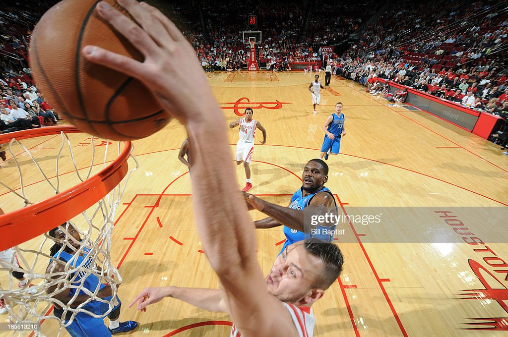 <a gi-track='captionPersonalityLinkClicked' href=/galleries/search?phrase=Donatas+Motiejunas&family=editorial&specificpeople=5561687 ng-click='$event.stopPropagation()'>Donatas Motiejunas</a> #20 of the Houston Rockets dunks the ball against the Dallas Mavericks during a 2013 NBA pre-season game on October 21, 2013 at the Toyota Center in Houston, Texas.