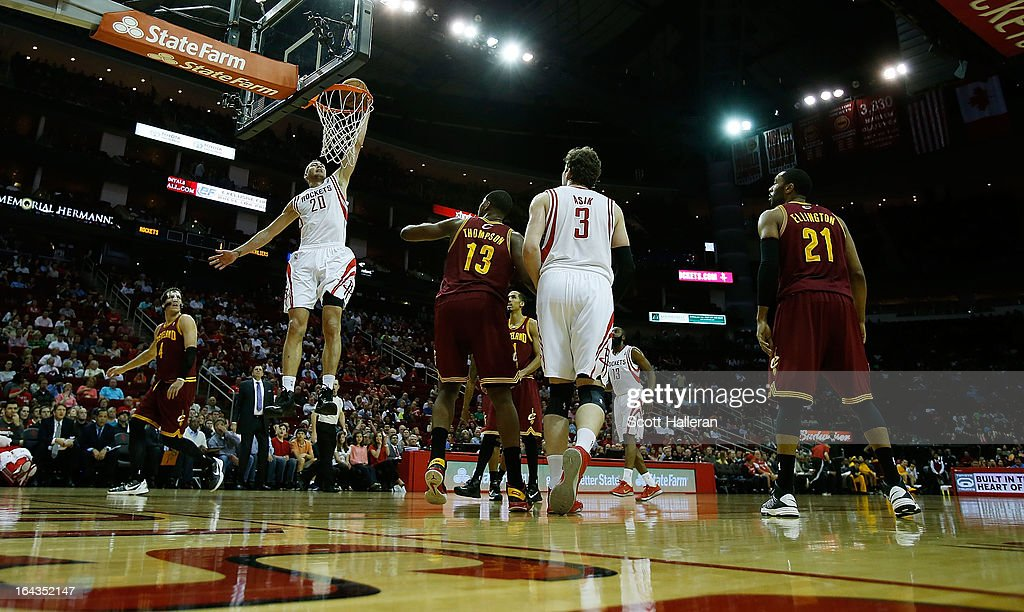 <a gi-track='captionPersonalityLinkClicked' href=/galleries/search?phrase=Donatas+Motiejunas&family=editorial&specificpeople=5561687 ng-click='$event.stopPropagation()'>Donatas Motiejunas</a> #20 of the Houston Rockets goes up for a shot against the Cleveland Cavaliers defenders at Toyota Center on March 22, 2013 in Houston, Texas.