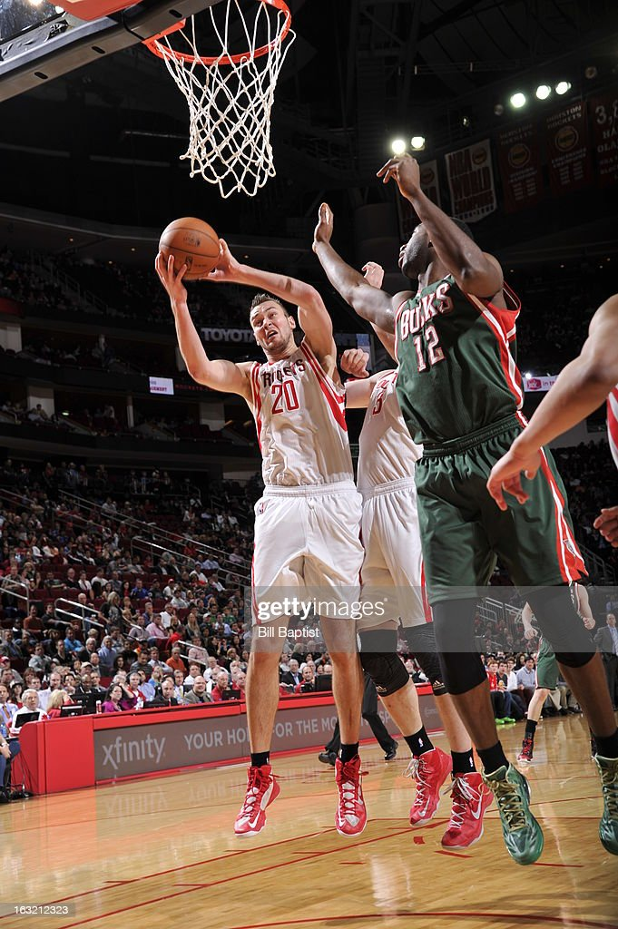 <a gi-track='captionPersonalityLinkClicked' href=/galleries/search?phrase=Donatas+Motiejunas&family=editorial&specificpeople=5561687 ng-click='$event.stopPropagation()'>Donatas Motiejunas</a> #20 of the Houston Rockets grabs a rebound against the Milwaukee Bucks on February 27, 2013 at the Toyota Center in Houston, Texas.