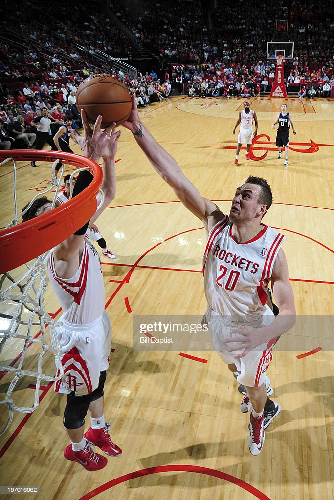 <a gi-track='captionPersonalityLinkClicked' href=/galleries/search?phrase=Donatas+Motiejunas&family=editorial&specificpeople=5561687 ng-click='$event.stopPropagation()'>Donatas Motiejunas</a> #20 of the Houston Rockets grabs the ball along side Jeremy Lin #7 of against the Minnesota Timberwolves on March 15, 2013 at the Toyota Center in Houston, Texas.
