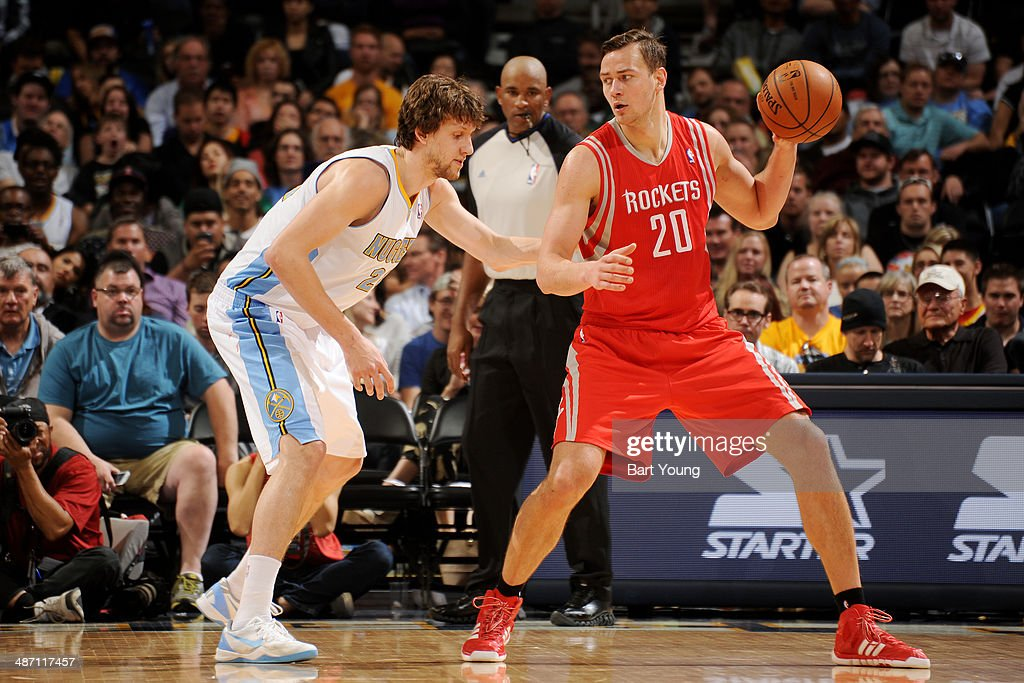 Donatas Motiejunas #20 of the Houston Rockets handles the ball against the Jan Vesely #24 of the Denver Nuggets on April 9, 2014 at the Pepsi Center in Denver, Colorado.