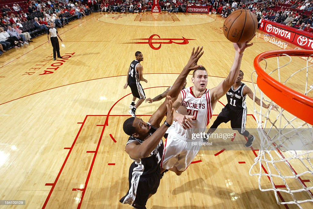 <a gi-track='captionPersonalityLinkClicked' href=/galleries/search?phrase=Donatas+Motiejunas&family=editorial&specificpeople=5561687 ng-click='$event.stopPropagation()'>Donatas Motiejunas</a> #20 of the Houston Rockets shoots the ball over Derrick Brown #1 of the San Antonio Spurs during a pre-season game on October 14, 2012 at the Toyota Center in Houston, Texas.