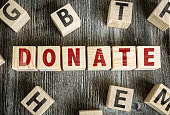 Wooden Blocks with the text: Donate