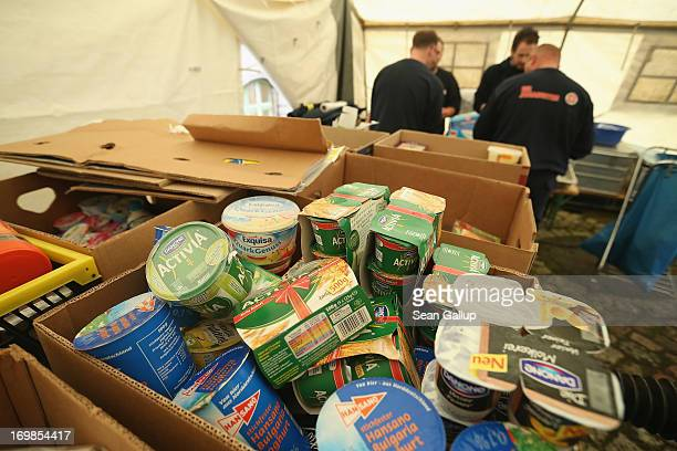 Donated food sits in boxes in a mess tent of the Johanniter charity at an evacuation center in a school gymnasium for evacuees who had been forced to...
