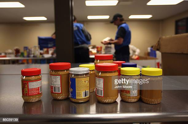 Donated peanut butter is set aside to be crosschecked with lists of recalled brands before being repackaged for distribution at the Care and Share...