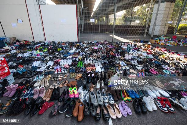 Donated shoes sit in the Westway Sports Centre near to the site of the Grenfell Tower fire on June 15 2017 in London England At least twelve people...
