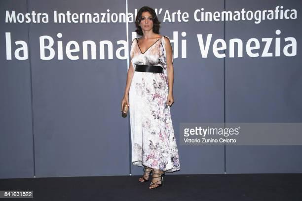Donatella Finocchiaro walks the red carpet ahead of the 'Nato A Casal Di Principe' screening during the 74th Venice Film Festival at Sala Giardino on...