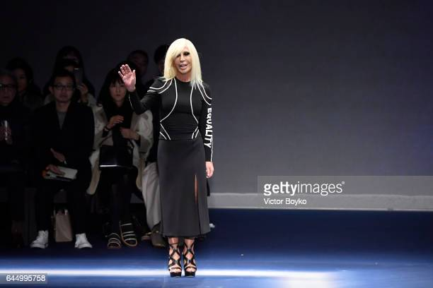 Donatella Versace aknowledges the applause of the audience at the Versace show during Milan Fashion Week Fall/Winter 2017/18 on February 24 2017 in...