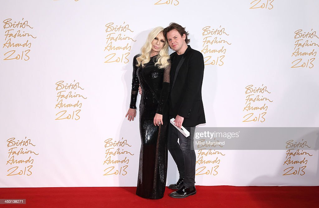 Donatella Versace and Christopher Kane poses in the winners room at the British Fashion Awards 2013 at London Coliseum on December 2, 2013 in London, England.