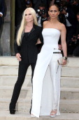 Donatella Versace and Jennifer Lopez attend the Versace show as part of Paris Fashion Week Haute Couture Fall/Winter 20142015 at on July 6 2014 in...