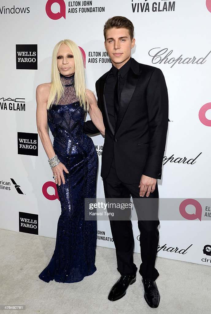 Donatella Versace and Nolan Gerard Funk arrive for the 22nd Annual Elton John AIDS Foundation's Oscar Viewing Party held at West Hollywood Park on March 2, 2014 in West Hollywood, California.