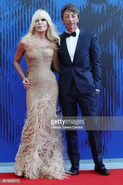 Donatella Versace and Pierpaolo Piccioli attend the The 1st Franca Sozzani Award during the 74th Venice Film Festival at Sala Giardino on September 1...